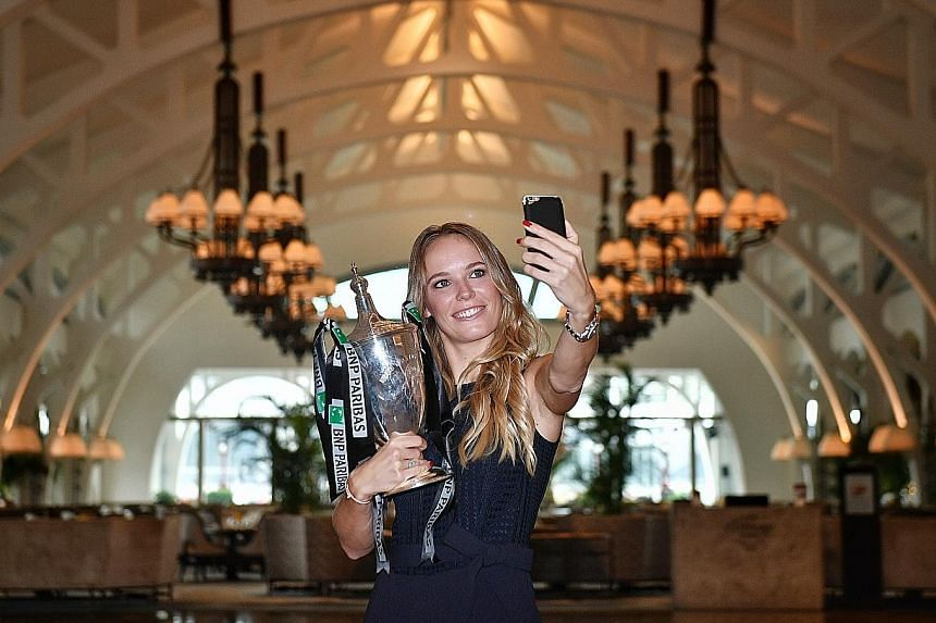 Former world No. 1 Caroline Wozniacki at Clifford Pier with the Billie Jean King Trophy after winning the WTA Finals. The top ranking changed hands seven times this year without anyone establishing real dominance.