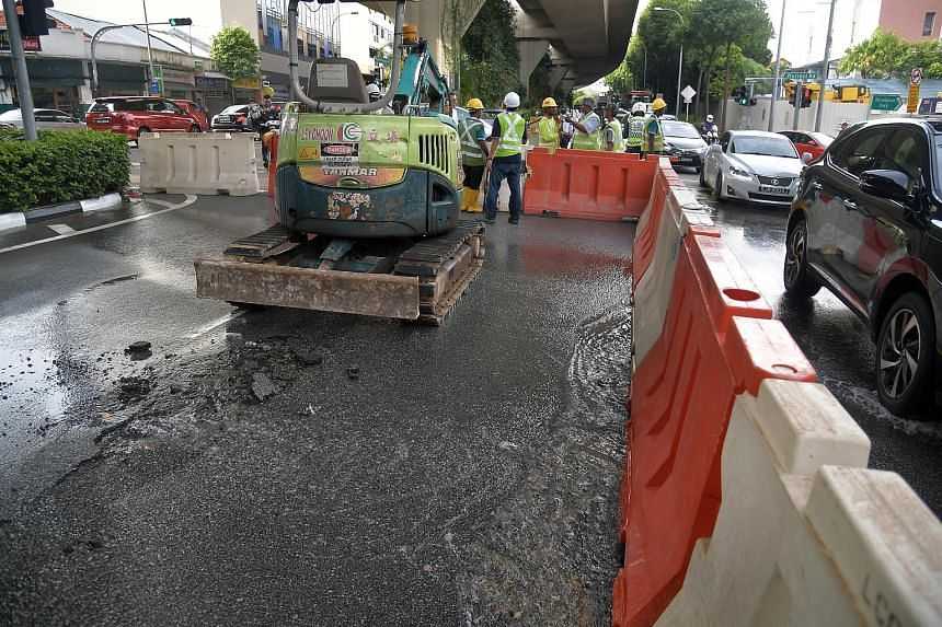 Above: Some households in Choa Chu Kang received brownish water after a pipe burst, disrupting water supply on Sunday. A town council spokesman said this was due to natural sediments in the water tank and flushing of the tank and pipes had been condu