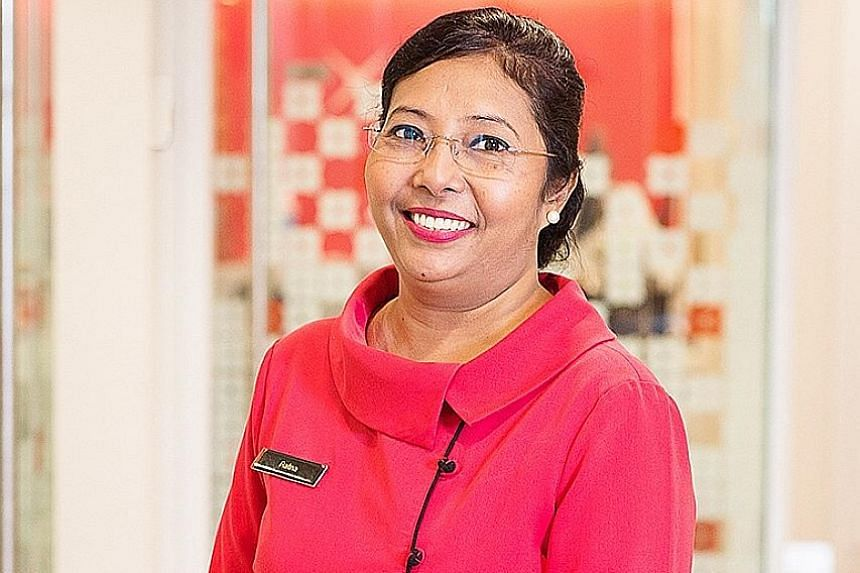 "Ms Ratna Manoharan said all the skills training she has received at DBS has given her ""more confidence in serving customers""."