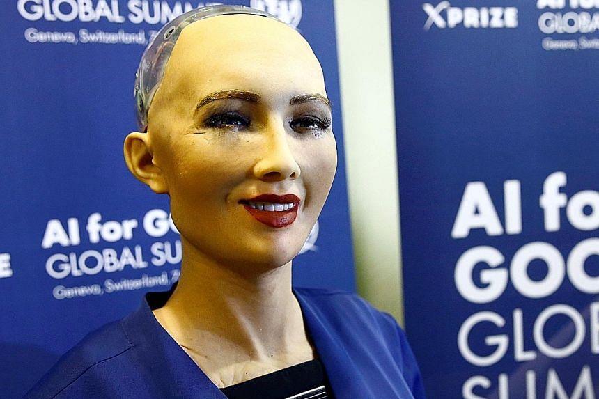 Top: Saudi women at a Riyadh film festival. The kingdom is expected to lift a public ban on cinemas. Above: Sophia the robot has been granted Saudi citizenship.