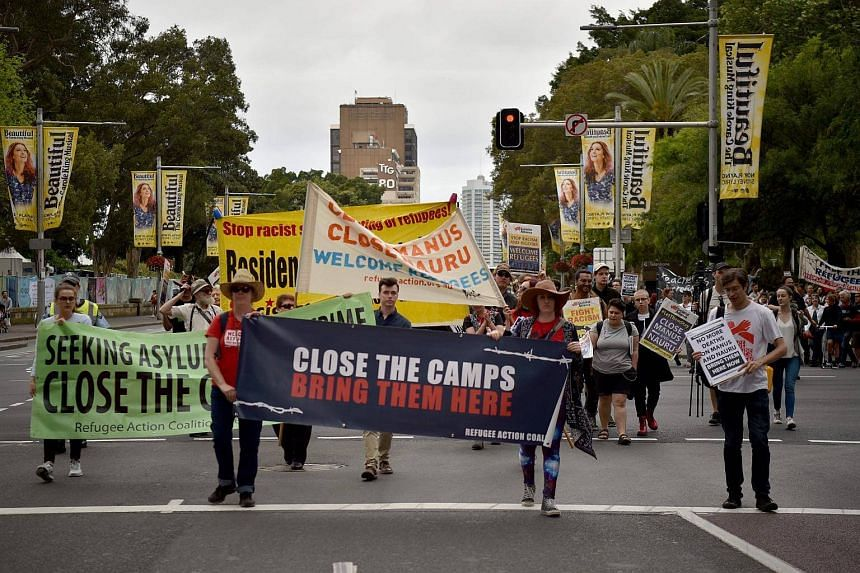 Protesters march in Sydney against the moving of refugees in Papua New Guinea.