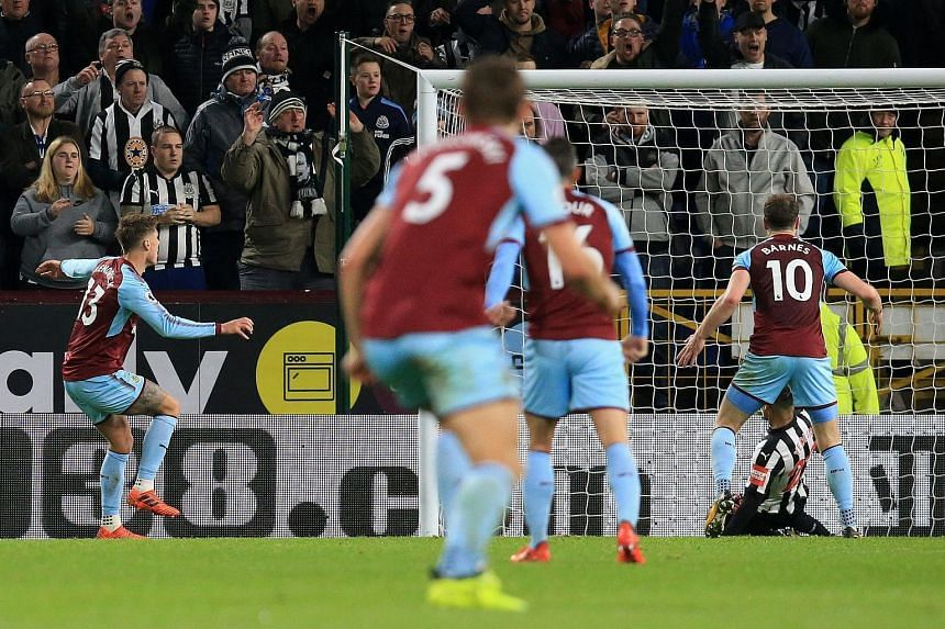 Jeff Hendrick (left) scores his team's first goal during the English Premier League football match between Burnley and Newcastle United.