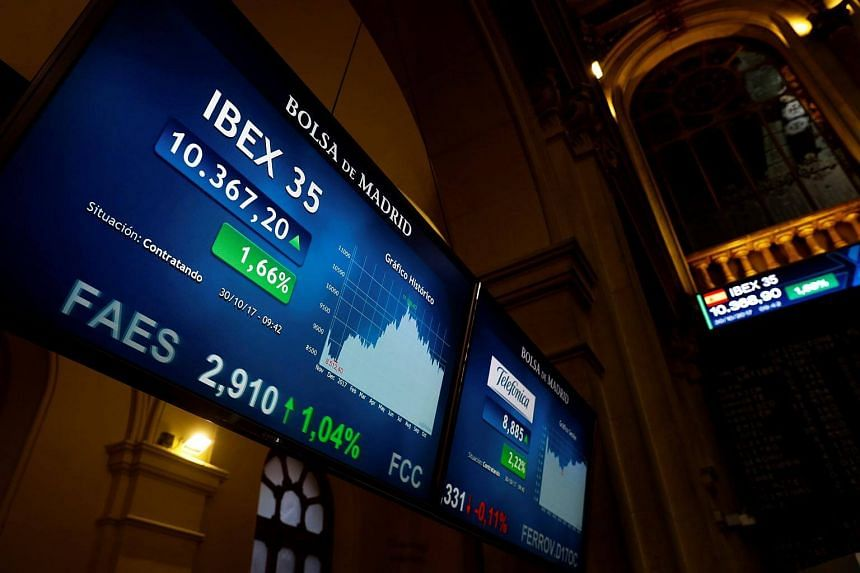 A screen shows an evolution of Spanish market's main index Ibex 35 at Madrid's Stock Exchange in Madrid, Spain.