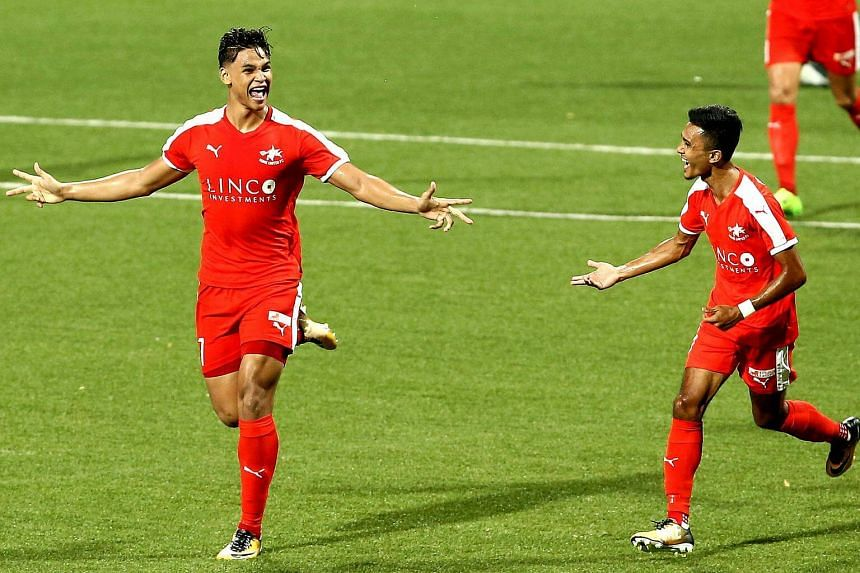 Irfan Fandi (left) celebrating after scoring the opening goal for Home United in the Great-Eastern Hyundai S.League match against Warriors FC at the Jalan Besar Stadium on July 25, 2017.