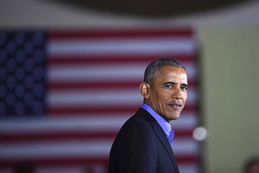 Former president Barack Obama speaks during a rally in Newark, New Jersey.