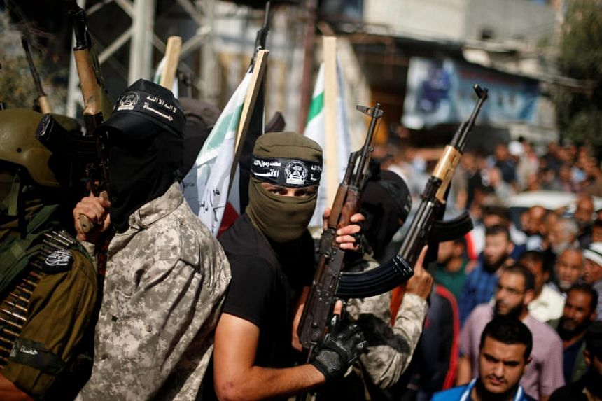 Palestinian militants take part in the funeral of their comrades in the central Gaza Strip Oct 31, 2017.
