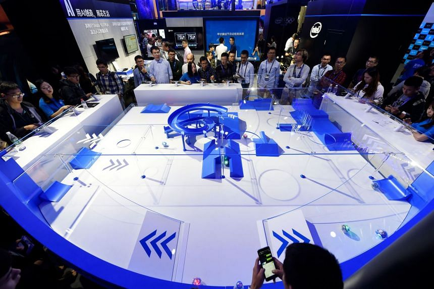 Visitors watching a performance of spherical robots at the Intel booth at the Computing Conference 2017 in Hangzhou, Zhejiang province, on Oct 11, 2017.