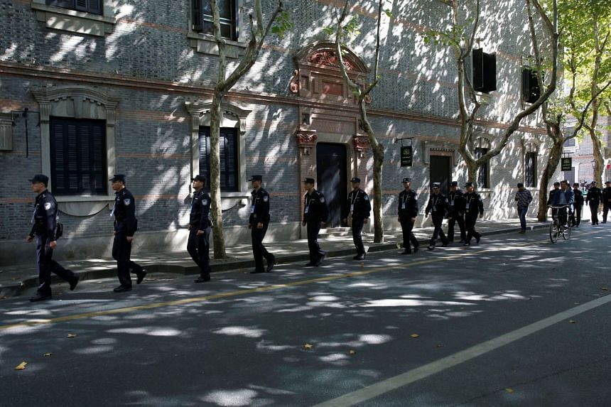 Police officers walking along a blocked road near the Museum of the First National Congress of the Chinese Communist Party, which Chinese President Xi Jinping and top party officials were visiting, on Oct 31, 2017.