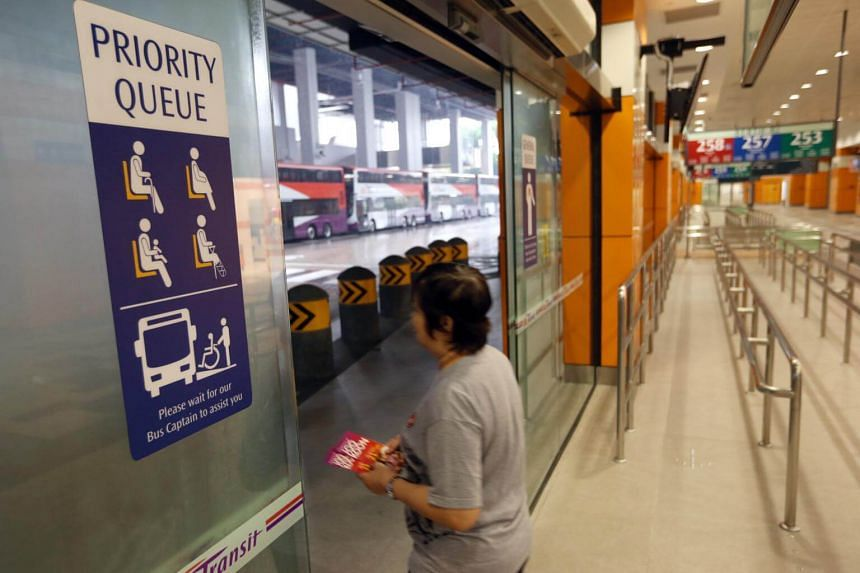 """Brightly coloured signs mark out priority zones near the boarding berths at the Joo Koon Integrated Transport Hub.Altogether 446 transport staff received awards for displaying """"exemplary service and gracious behaviour during their course of work""""."""