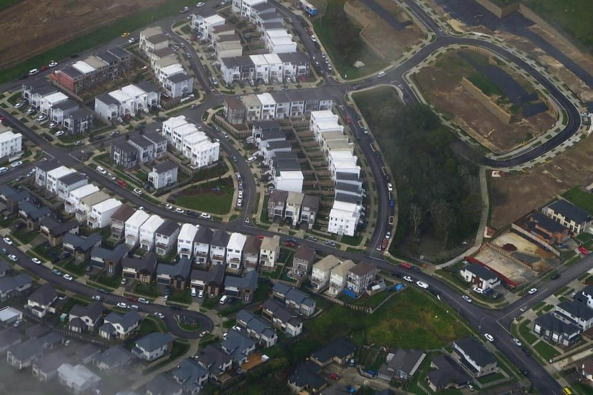 A newly built housing estate can be seen next to another that is under construction in a suburb of Auckland, New Zealand.