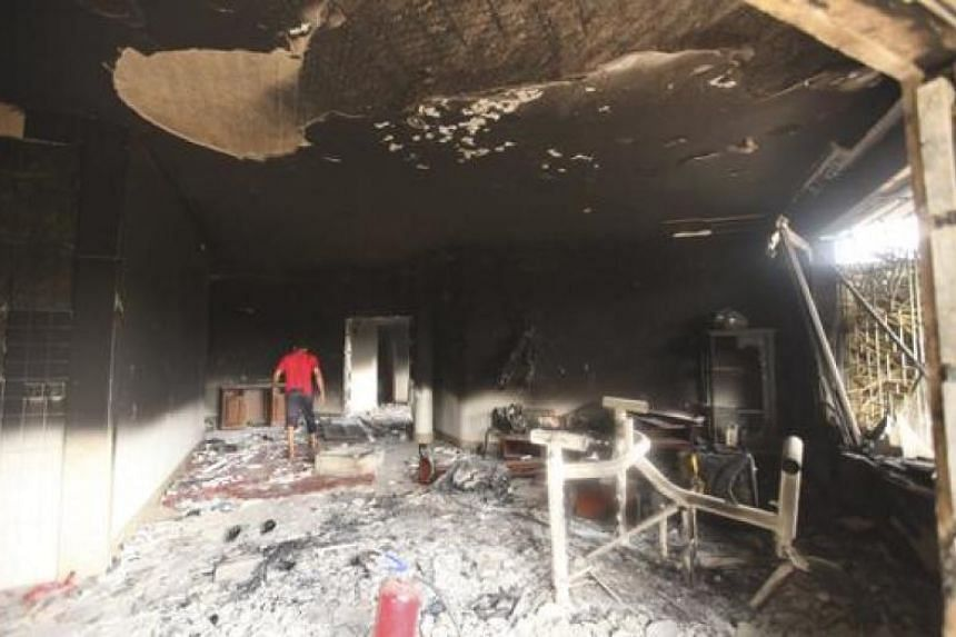 A man walks inside the US consulate, which was attacked and set on fire by gunmen in Benghazi in September 2012.