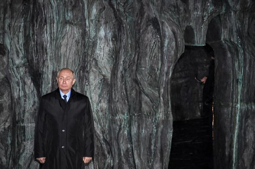 Russian President Vladimir Putin attends a ceremony to unveil the country's first national memorial to victims of Soviet-era political repressions, titled The Wall of Grief in downtown Moscow, Russia, on Oct 30, 2017.