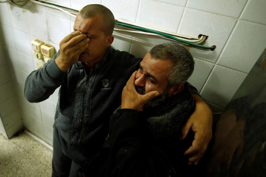 Palestinians react at a hospital after their relative was killed in a tunnel near the border between Israel and central Gaza Strip on Oct 30, 2017.