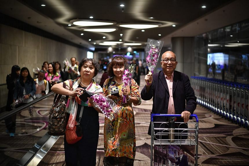 Passengers from Cathay Pacific CX659 from Hong Kong, the first flight to arrive at Terminal 4, were greeted with orchids and welcomed by airport staff.