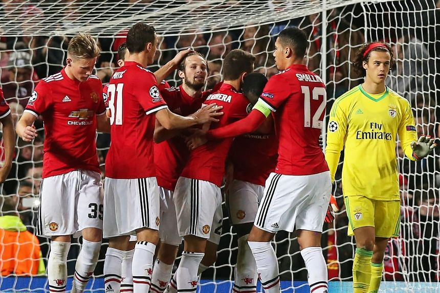 Manchester United's Daley Blind (centre) celebrates with his team mates after scoring the 2-0 lead from the penalty spot.