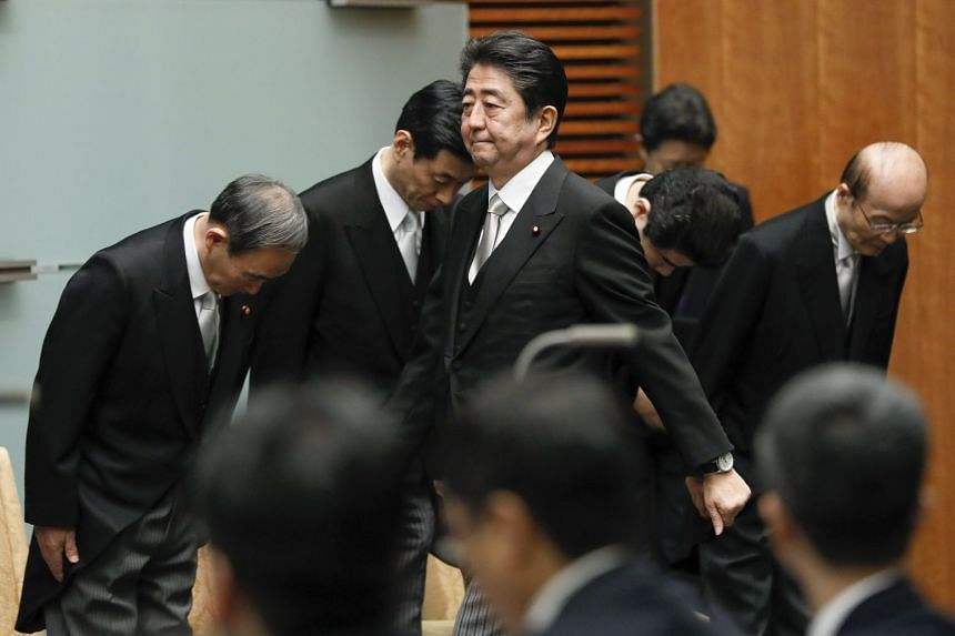 Abe walks towards the podium for a news conference after being renamed as prime minister.