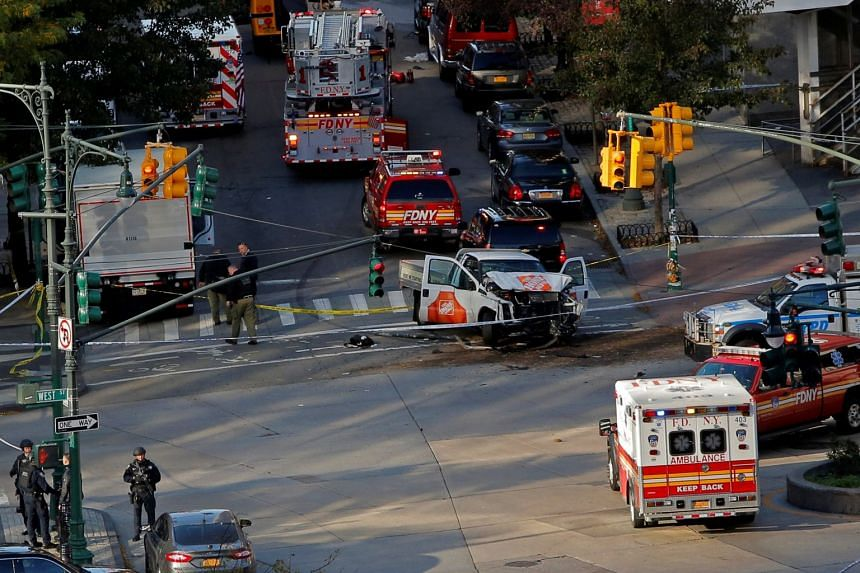 Emergency crews attend the scene of an alleged shooting incident on West Street in Manhattan.