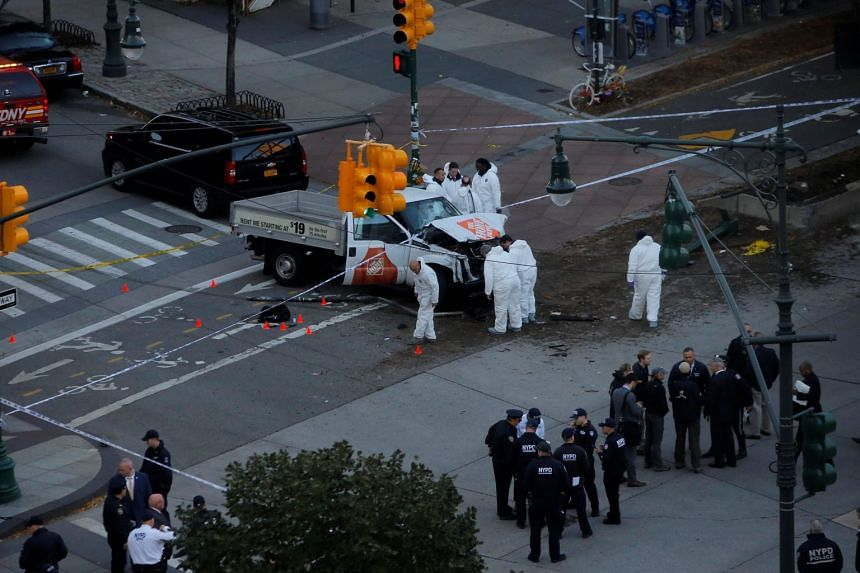Police investigate a vehicle allegedly used in a ramming incident on the West Side Highway in Manhattan.
