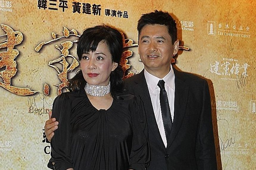 Singaporean Jasmine Tan (with husband Chow Yun Fat) says she still thinks about her daughter today.