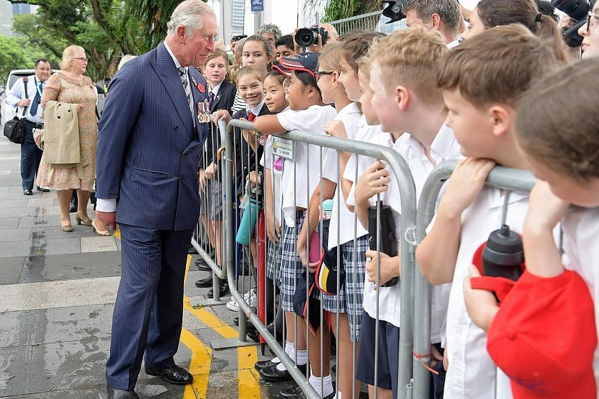 Prince Charles meeting schoolchildren and other members of the public yesterday at the Cenotaph, where he laid a wreath in memory of those who died fighting in the two world wars. The Prince and his wife Camilla, who began their Commonwealth tour in