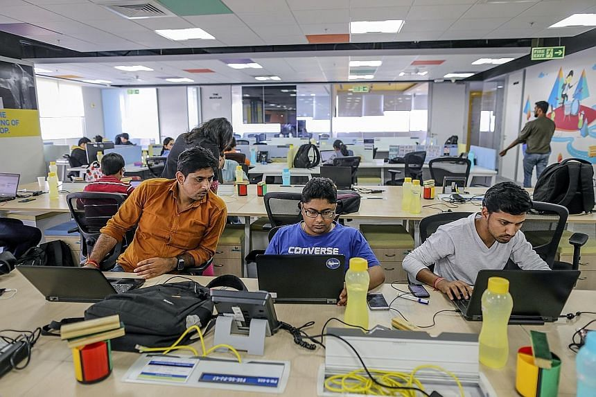 Employees at e-commerce company Flipkart Online Services in Bengaluru. India's IT services industry is worth $204.2 billion and employs nearly four million workers. But growing protectionism in the West, coupled with technologies such as artificial i