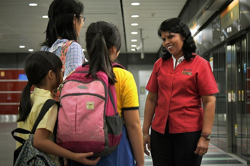 Buona Vista MRT station service ambassador Vasaki Perumal said her job has its challenges, but she would always retain her smile. She often leads a man with visual disability and his guide dog to the bus stop, and then helps him find a seat on the bu