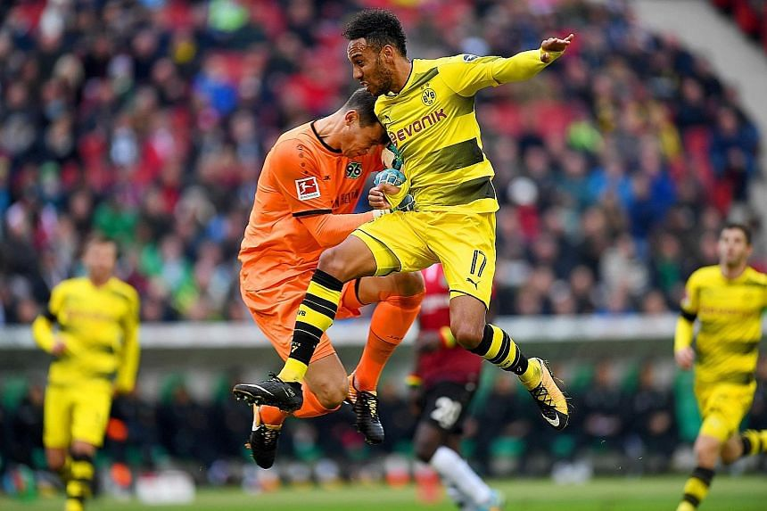 Dortmund forward Pierre-Emerick Aubameyang (right) and Hannover goalkeeper Philipp Tschauner during the 4-2 defeat that cost Dortmund their place atop the Bundesliga table. Aubameyang, the Bundesliga's top scorer last season, has not scored a goal in