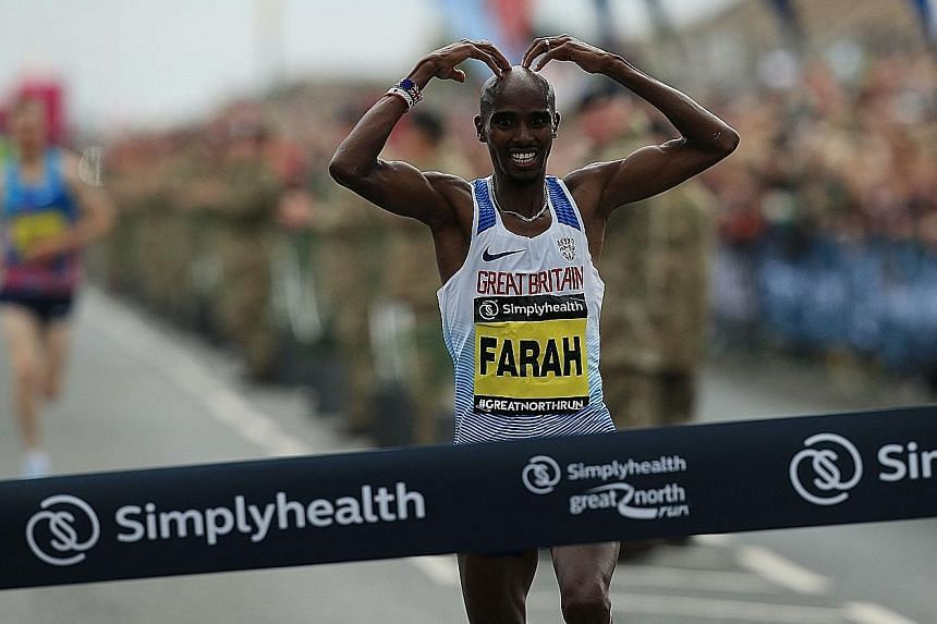 Mo Farah doing his trademark 'Mobot' pose after winning the Great North Run in September. He will be focusing on the marathon, having retired from the track.