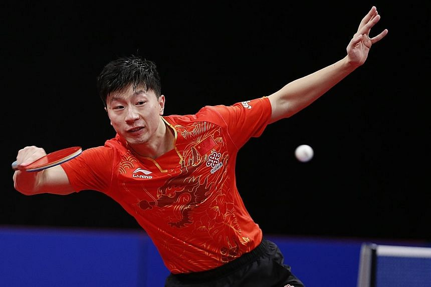 Ma Long in action at the Men's World Cup in Liege, Belgium last month. He and team-mates Fan Zhendong and Xu Xin were each fined US$20,000 (S$27,250) for quitting a tournament in Chengdu in June to protest against the redesignation of their coach.