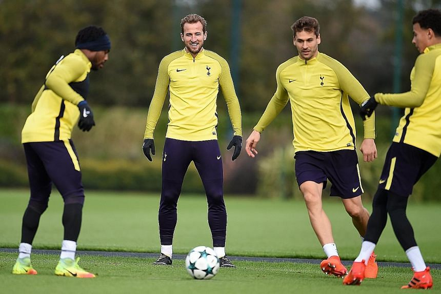 Tottenham striker Harry Kane (centre) in training with his team-mates. Spurs have not beaten European champions Real Madrid in five previous attempts and they will need Kane, who was badly missed at Old Trafford as Spurs slumped to a 1-0 defeat by Ma