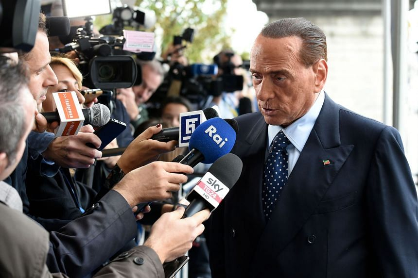 Silvio Berlusconi speaks to journalists ahead of a meeting in Brussels on Oct 19, 2017.