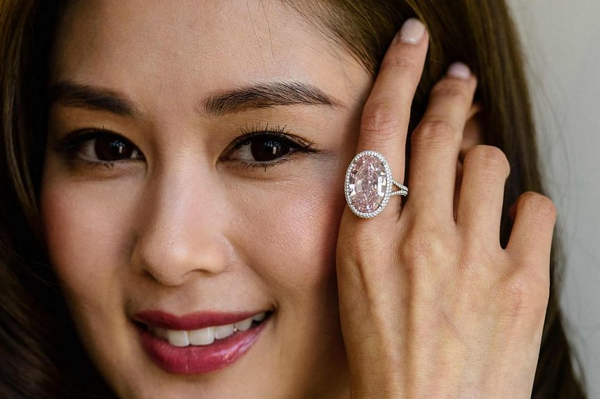 A 14.93-carat pink gemstone forms the centre-piece of the diamond-studded ring
