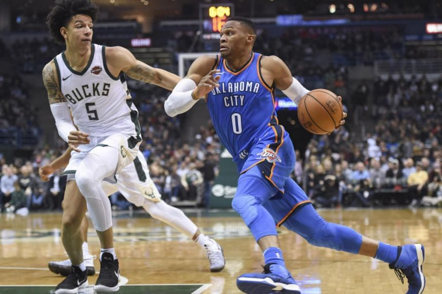 Oklahoma City Thunder guard Russell Westbrook (0) drives for the basket against Milwaukee Bucks forward D.J. Wilson (5) in the second quarter at BMO Harris Bradley Center.
