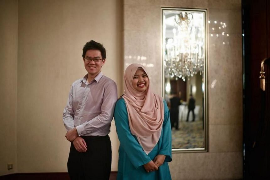 Volunteers Thomas Liew, 35, a senior manager in business excellence and Nurul Fatimah, 18, a polytechnic student.