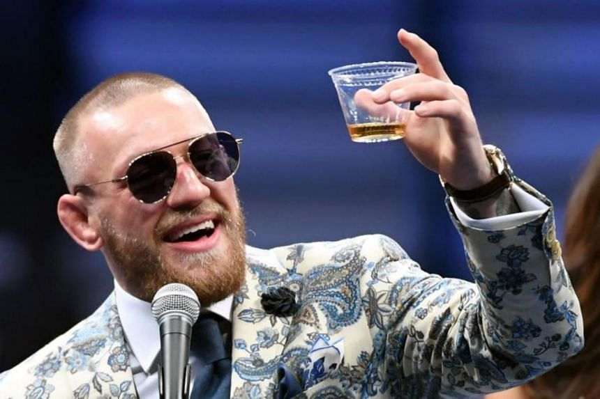 UFC lightweight champion Conor McGregor holds up a cup of his Notorious-branded Irish whiskey at a news conference following his 10th-round TKO loss to Floyd Mayweather Jr. in their super welterweight boxing match at T-Mobile Arena on Aug 26, 2017 in