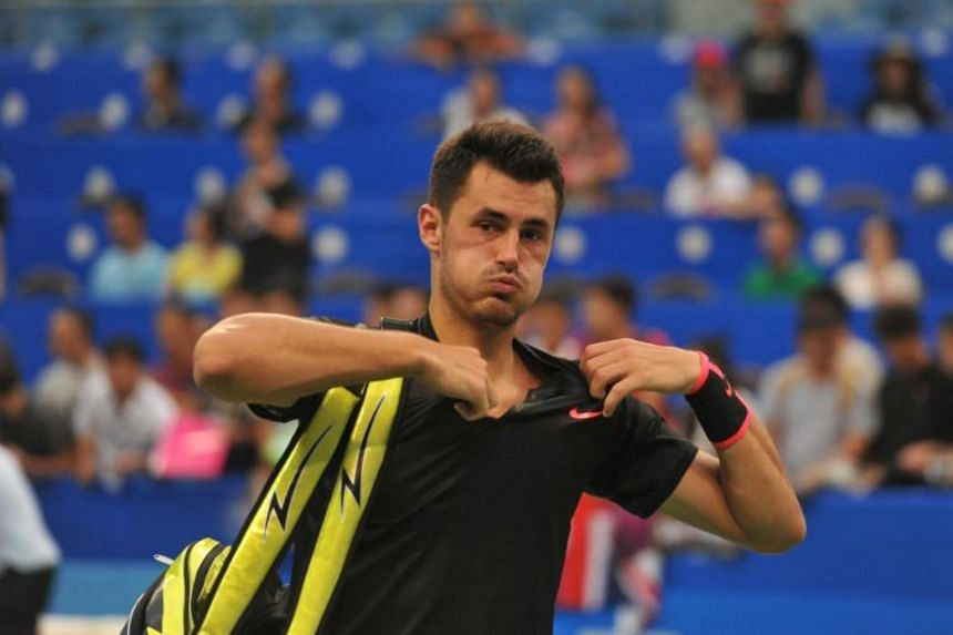 Bernard Tomic of Australia prepares to leave the court after he lost to Kyle Edmund of Britain during their men's singles first round match at the ATP Chengdu Open tennis tournament in Chengdu, on Sept 26, 2017.