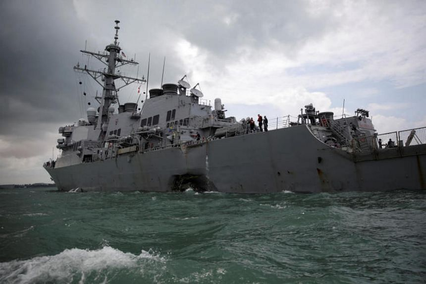 The USS Navy guided-missile destroyer, USS John S. McCain, is seen after a collision, in Singapore waters on Aug 21, 2017.