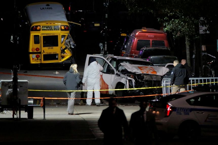 Police investigators examining a truck that was used in an attack on the West Side Highway in Manhattan, New York, on Nov 1, 2017.
