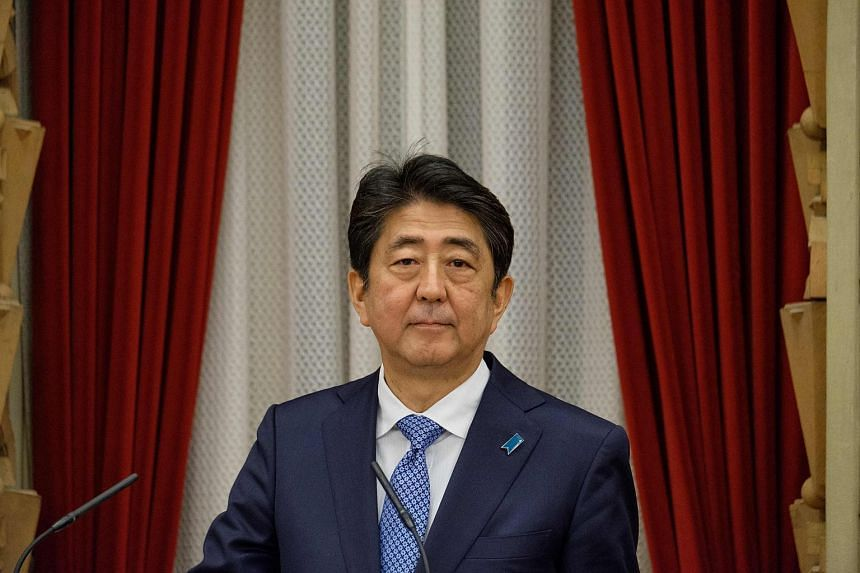 Japanese Prime Minister Shinzo Abe delivers a speech before a banquet at the Prime Minister's office in Tokyo.