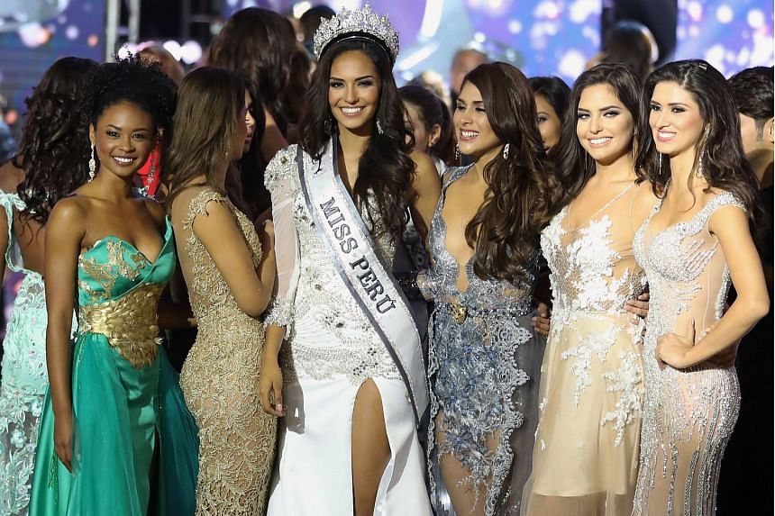 Peruvian beauty contestant and winner of the Miss Peru 2017 Romina Lozano (centre), being congratulated by other contestants.