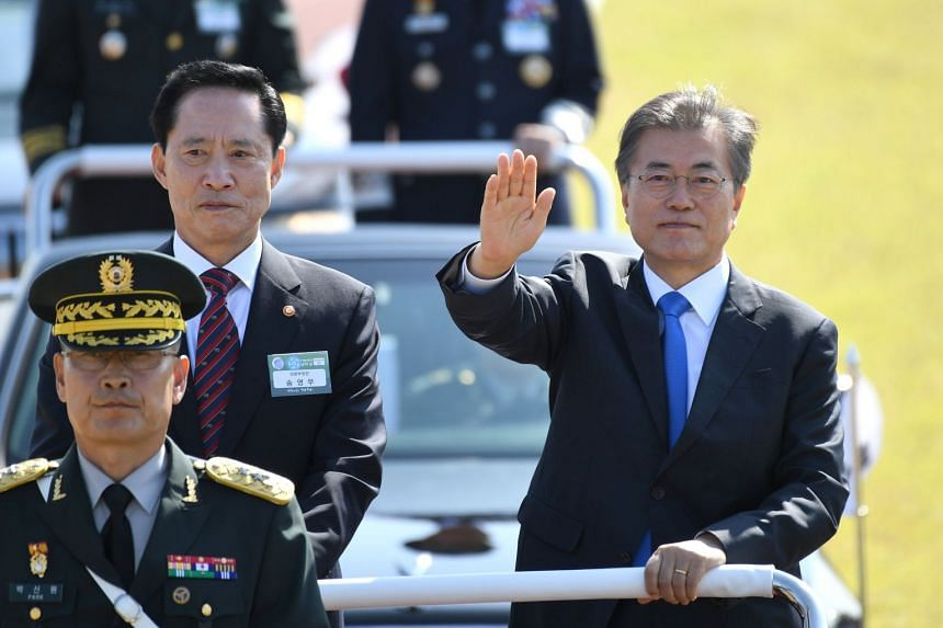 South Korean President Moon Jae In and Defense Minister Song review the troops during a commemoration ceremony marking South Korea's Armed Forces Day.
