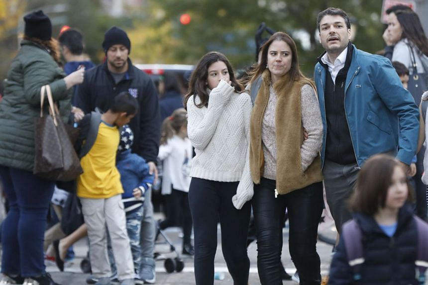 Parents pick up their children from P.S./I.S.-89 school after the shooting.