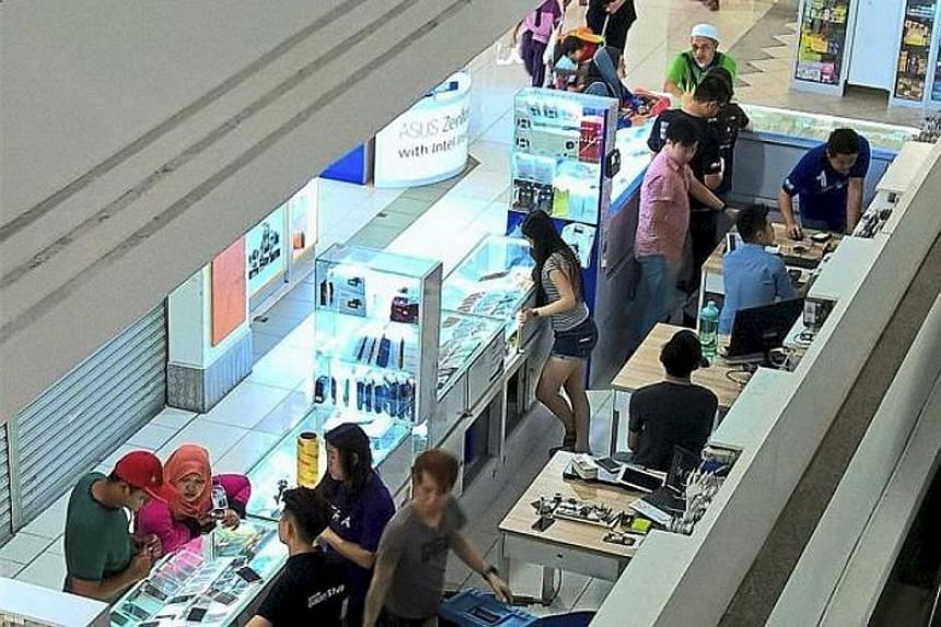 Mobile phone shops in Malaysia. The massive data breach was first reported last month by Lowyat.net.