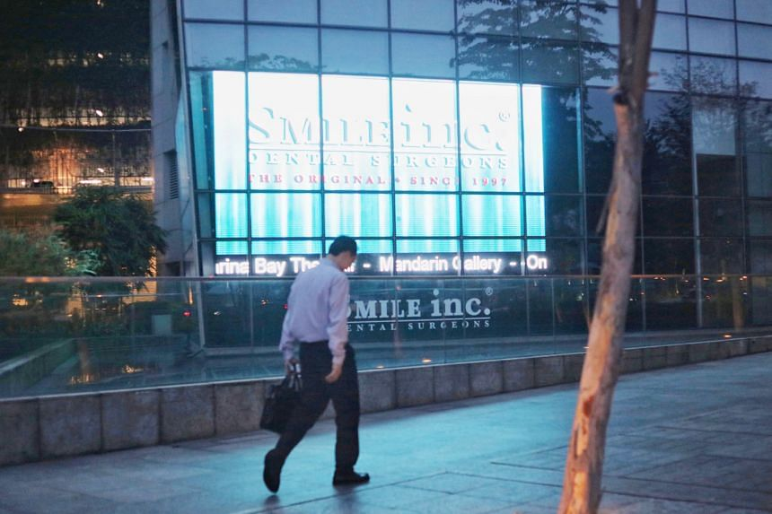 """The panels at the The Sail @ Marina Bay that the management corporation (MC) said stuck out """"like a sore thumb"""". But Smile Dental Surgeons said the MC had acquiesced in the display arrangements."""