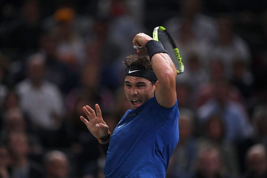 Nadal returns the ball to South Korea's Hyeon Chung during their second-round match, Nov 1, 2017.