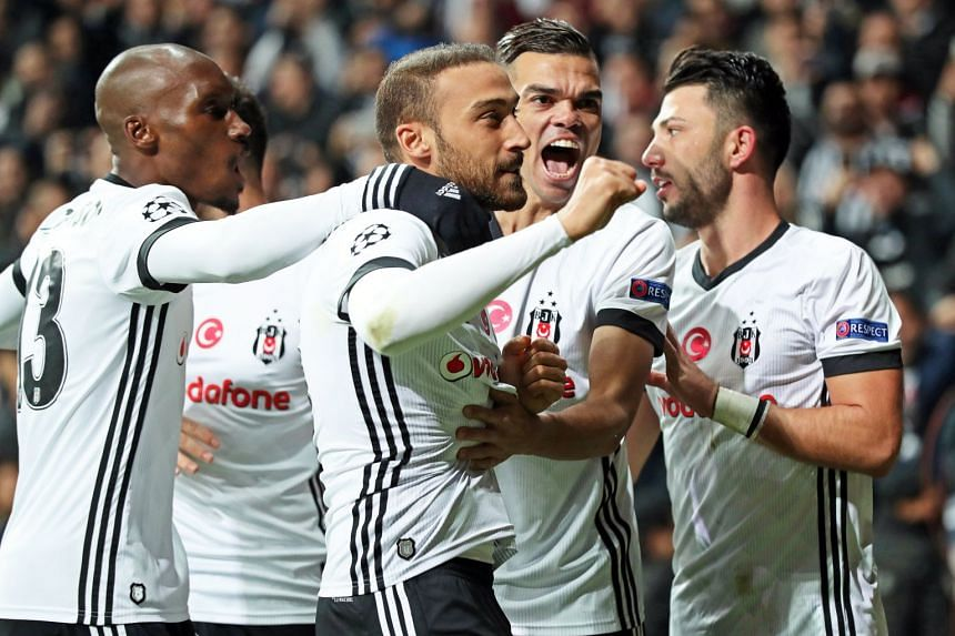 Besiktas' Cenk Tosun (second left) celebrates with his team mates after scoring the 1-1 equalizer from the penalty spot.