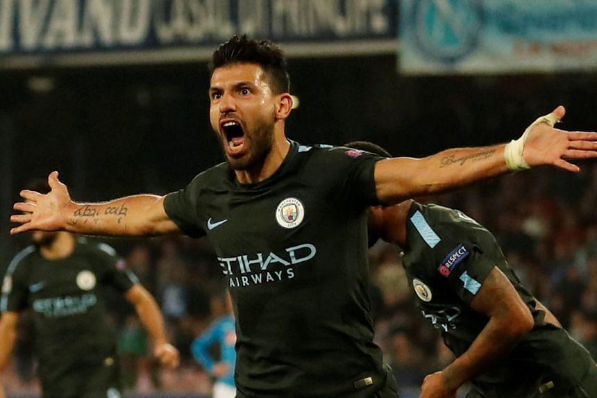 Manchester City's Sergio Aguero celebrates scoring their third goal.