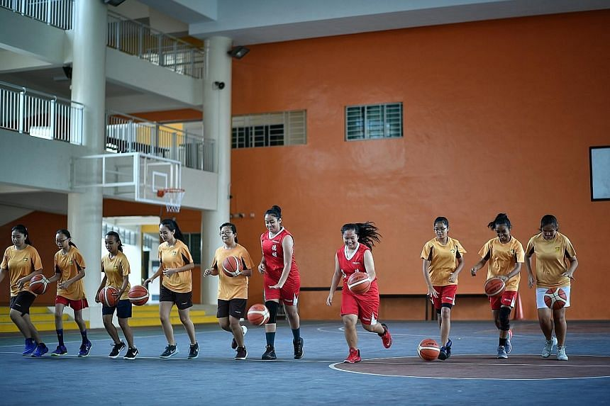 Jurong Secondary School's basketball teams are made up of students from different races. Observers said the mindset that some sports are associated with specific ethnic groups still persists, and it is important that parents do not just impose their