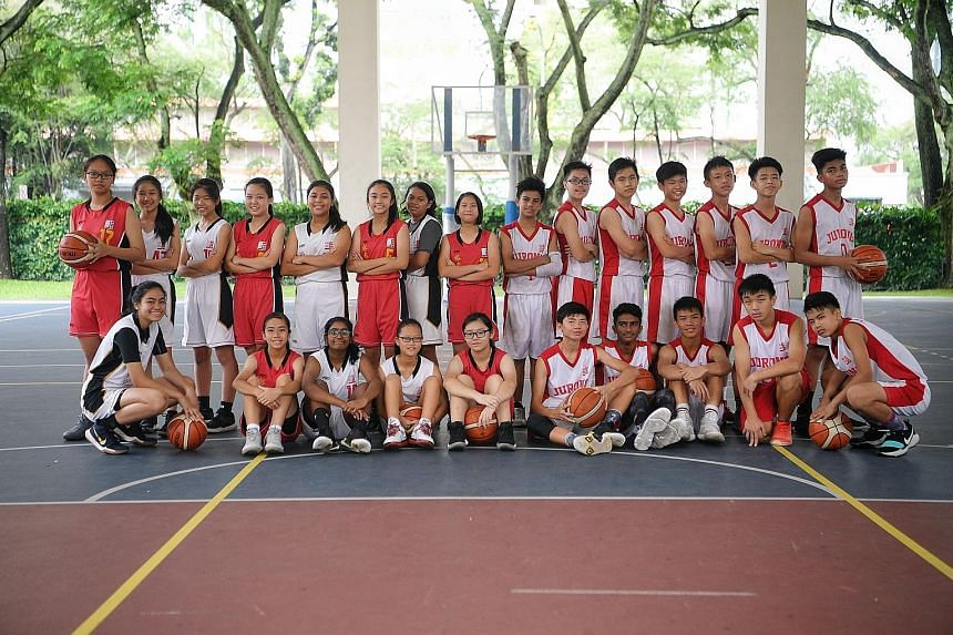 At Dunman Secondary School, Chinese students account for only half of the basketball players.