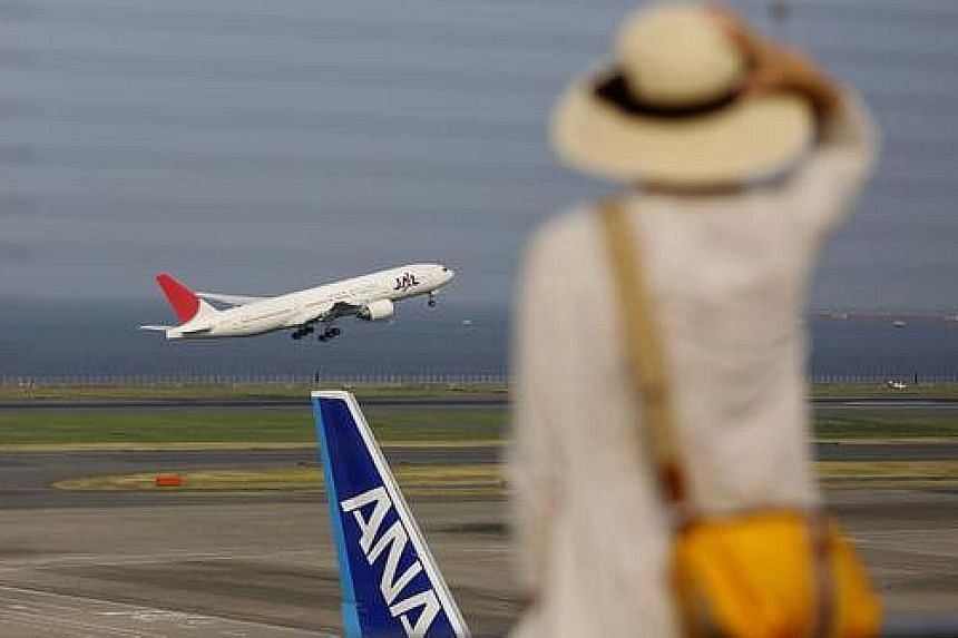 ANA's net profits for the first half-year to September rose to a record 118.4 billion yen.